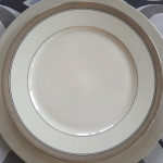 catering plates and silverware with metallic trim