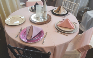 a table set up for formal catering