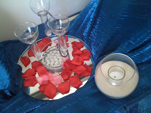 A rose centerpiece on blue linen used for a catering event in Columbus OH