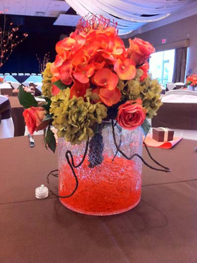 a pink rose centerpiece used for a wedding catering