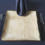 catering plates and silverware that looks like bamboo