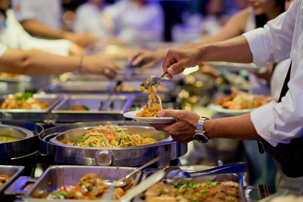 Man serving food from buffet